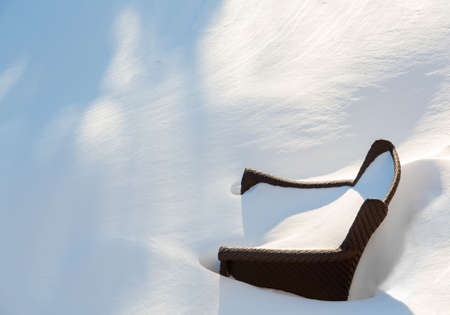 snow drift: Outdoor garden chair normally by poolside buried by snow in deep drift during blizzard of January 2016 Stock Photo