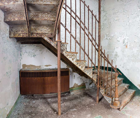 lunatic: Stairs and cast iron rails inside Trans-Allegheny Lunatic Asylum in Weston, West Virginia, USA