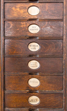 filing system: Wooden drawers of an ancient filing system with hand lettered labels for each subject