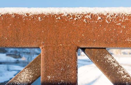 pedestrian bridge: Abstract pattern of rusty framework and structure of pedestrian bridge in snow in winter