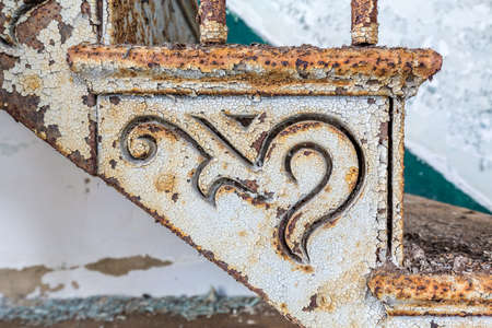 cast iron: Close up detail of the shapes in the rusty paintwork of old cast iron staircase