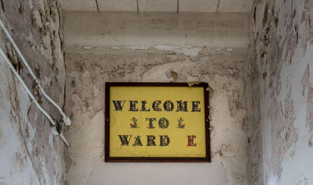 lunatic: Painted sign to Ward E inside Trans-Allegheny Lunatic Asylum in Weston, West Virginia, USA