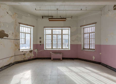 lunatic: Empty room with windows inside Trans-Allegheny Lunatic Asylum in Weston, West Virginia, USA