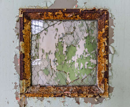 shards: Scary image of broken glass in shards leading into an empty room in old hospital