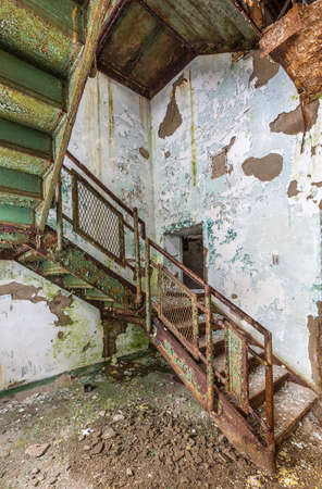 cast in place: Stairs and cast iron rails inside Trans-Allegheny Lunatic Asylum in Weston, West Virginia, USA
