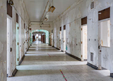 lunatic: Empty rooms off long corridor inside Trans-Allegheny Lunatic Asylum in Weston, West Virginia, USA