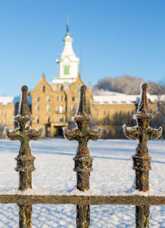 exterior shape: Close up of cast iron railings outside Trans-Allegheny Lunatic Asylum in Weston, West Virginia, USA