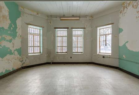 Empty room with windows inside Trans-Allegheny Lunatic Asylum in Weston, West Virginia, USA