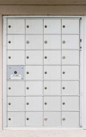 usps: Metal mailbox container for townhouses in development in USA Stock Photo