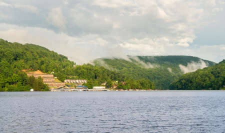 hillsides: Mist on the hillsides above Cheat Lake near Morgantown, West Virginia Stock Photo