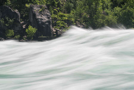 blurred motion: Blurred motion of Class six rapids in river by White Water Walk near whirlpool rapids at Niagara Falls