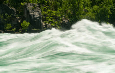 whirlpool: Blurred motion of Class six rapids in river by White Water Walk near whirlpool rapids at Niagara Falls
