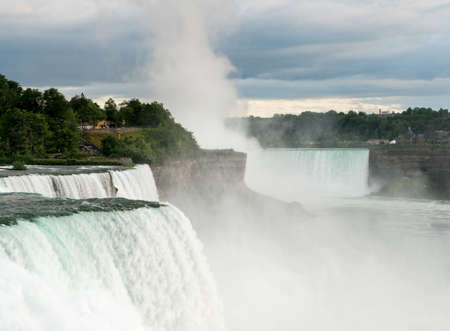 horseshoe falls: Canadian or Horseshoe waterfall in background with American Falls in foreground at Niagara Stock Photo