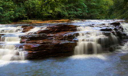 west river: Wide waterfall with blurred motion on Muddy Creek running into Cheat River off Route 26 in Preston County West Virginia