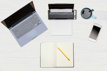 Tidy organized desk top with laptop, scanner and electronics with cup of coffee or tea on white wooden table for designer workspace Stock Photo