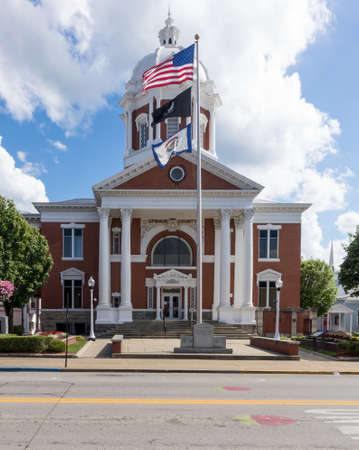 Flags fly in front of the Upshur County Court House in Buckhannon West Virginia