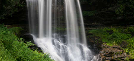 water  scenic: Panoramic view of Dry Falls waterfall cascading down the rocks on Mountain Water Scenic Byway near Highlands in North Carolina, USA Stock Photo