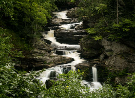 stream: Cullasaja Falls waterfall with blurred motion cascading down the rocks on the Mountain Water Scenic Byway near Highlands in North Carolina, USA Stock Photo