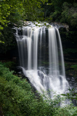 byway: Dry Falls waterfall with blurred motion cascading down the rocks on Mountain Water Scenic Byway near Highlands in North Carolina, USA Stock Photo