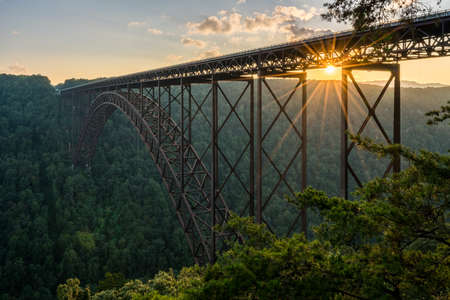 girders: Setting sun behind the girders of the high arched New River Gorge bridge in West Virginia