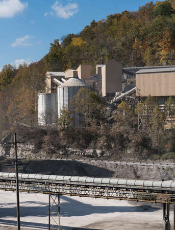 construction plant: Limestone quarry and crushed stone processing plant in wooded valley in West Virginia serving local road construction needs