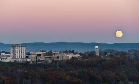 city and county building: MORGANTOWN, WEST VIRGINIA, USA - NOVEMBER 13: Harvest Supermoon rises over the campus of West Virginia University in Morgantown WV on November 13, 2016. This moon is the closest to the earth for several decades.