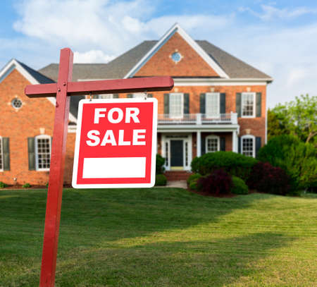 single family: For Sale   sign in front of large brick single family house in expansive grass yard for real estate opportunity