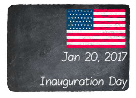 chalky: Inauguration Day written in chalk on a chalky natural slate blackboard isolated against white background with copy space