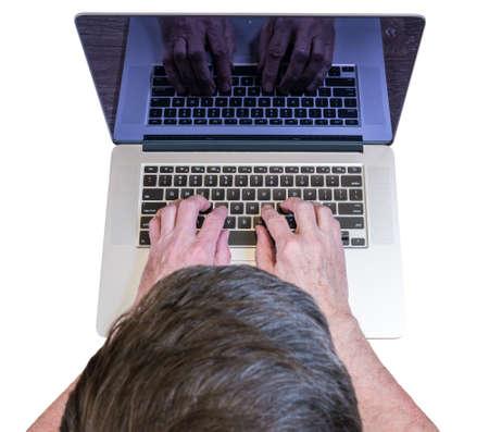 senior adult man: Senior caucasian adult man types on modern keyboard of laptop or ultrabook on isolated white background or desk