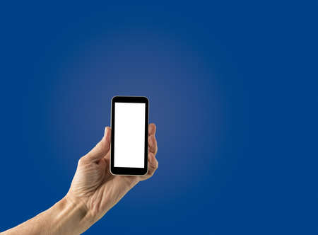 screenshot: Image of male hand holding smartphone with screen isolated ready for insertion of your application or screenshot against blue gradient background Stock Photo