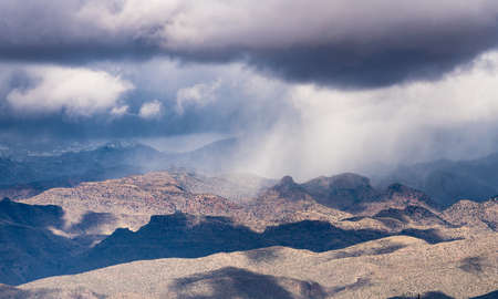 Unusual snow storm over the Santa Catalina mountains in desert outside Tucson Arizona Stock fotó