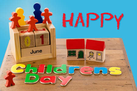 first nations: Childs wooden blocks and magnetic letters spell out Childrens Day for June first Stock Photo
