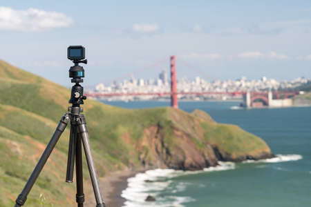 Focus on camera taking video or timelapse footage from Marin Headlands with the Golden Gate Bridge and San Francisco taken on clear spring day
