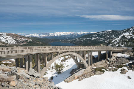 Donner bridge above Truckee lake in snow covered Sierra Nevada mountains from Donner Pass in April