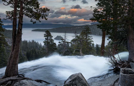 sierra nevada: Sunset at Emerald Bay on Lake Tahoe from the top of Lower Eagle Falls as the torrent of water from snow melt flows into the lake from Sierra Nevada Mountains.