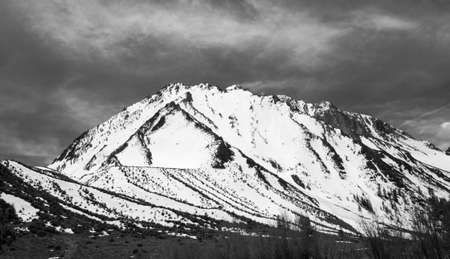 Patterns of snow covered mountains in picturesque Convict Lake in Sierra Nevada California