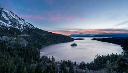 sierras: Sunrise at Emerald Bay on Lake Tahoe between California and Nevada with snow covered Sierra Nevada Mountains