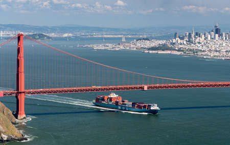 mol: SAN FRANCISCO - APRIL 19: MOL container ship enters San Francisco Bay under Golden Gate Bridge on April 19, 2017. The MOL Guardian is 275m long.