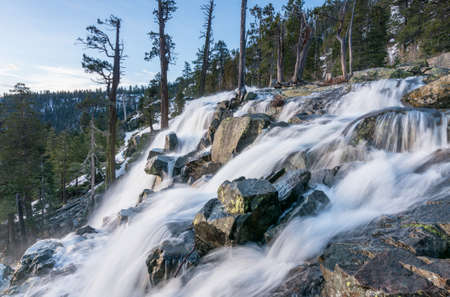 sierras: Sunrise at Emerald Bay on Lake Tahoe from the top of Lower Eagle Falls. Torrent of water from snow melt flows into the lake from Sierra Nevada Mountains