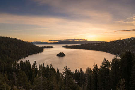inlet bay: Sunrise at Emerald Bay on Lake Tahoe between California and Nevada with snow covered Sierra Nevada Mountains