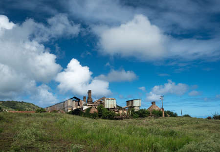 antique factory: Old and abandoned buildings used for sugar cane in Koloa sugar mill on Hawaiian island of Kauai Stock Photo