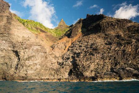 ridge of wave: Kalalau trail path crosses steep ridge on Na Pali coastline in Kauai from sunset cruise