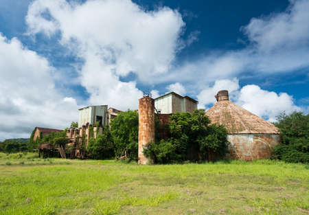 Old and abandoned buildings used for sugar cane in Koloa sugar mill on Hawaiian island of Kauai Stock Photo