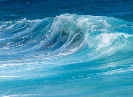 water wave: Cresting ocean waves taken with high shutter speed to show droplets of water in the surf