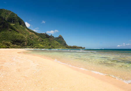 water wave: View down the sand at Tunnels Beach in summer on Hawaiian island of Kauai on North Shore