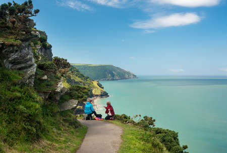 lynmouth: LYNMOUTH, DEVON UK – JULY 24:  Artists on the South West Coast Path on 24 July 2017 in Lynmouth, UK. The highest point on this path is 1043 feet above the sea.