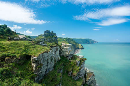walk path: Hiker on the headland in Valley of the Rocks on South West coast path near Lynmouth