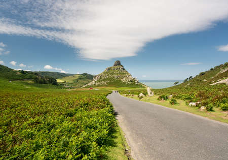 lynton: Road leading down to rock formation at Valley of the Rocks in North Devon, England Stock Photo