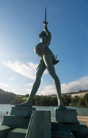 ILFRACOMBE, DEVON UK – JULY 24:  Sun illuminated Verity on 24 July 2017 in Ilfracombe, UK. The 25m tall Damien Hirst statue Verity was erected in 2012