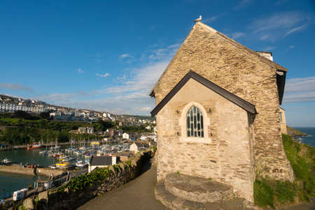 St Nicholas Chapel on the headland above the old harbour of Ilfracombe in North Devon, England Stock Photo